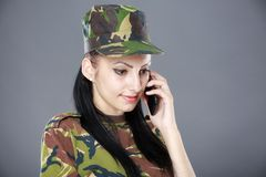 Image of attractive female soldier talking on cell phone Royalty Free Stock Photography