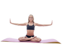 Image of attractive slim woman doing yoga on mat Royalty Free Stock Image