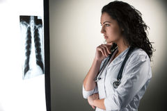 Image of attractive woman doctor looking at x-ray Stock Photo