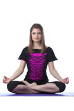 Image of attractive woman posing in lotus position Stock Photo