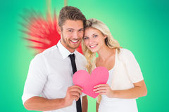 Image of attractive young couple holding pink heart Royalty Free Stock Image
