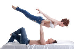 Image of attractive young gymnasts posing in bed Royalty Free Stock Photos