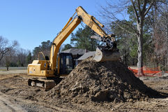 Construction site. An image of a backhoe at a construction site Stock Images