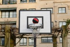 Ball flying into the basketball net. Image of ball flying into the basketball net royalty free stock images
