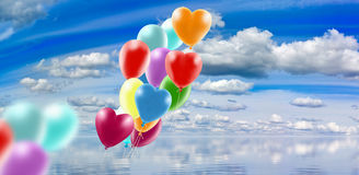 Image of balloons over the water against sky  background  closeup Royalty Free Stock Photos