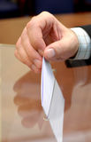 Image of a ballot box and hand putting a blank ballot inside Royalty Free Stock Photos