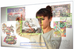 Image bank. Young woman manipulating a digital screen,  looking for images in a stock images data base Royalty Free Stock Image