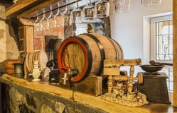 Vintage Still Life. Image of a bar crowded decorated with various wooden vintage objects Royalty Free Stock Photos