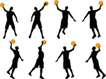 image - basketball player silhouette in slam pose, isolated on white background Royalty Free Stock Images