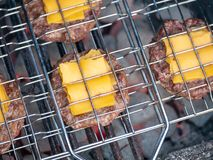 Image of bbq burger patties with cheese on grill stock image