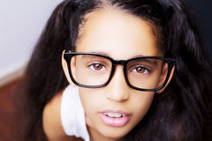 Image of a beautiful African young girl wearing glasses. Stock Photo