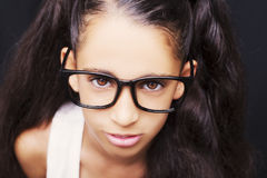 Image of a beautiful African young girl wearing glasses. Stock Photography
