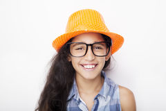 Image of a beautiful African young girl wearing glasses and hat Royalty Free Stock Image