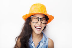 Image of a beautiful African young girl wearing glasses and hat Royalty Free Stock Photo