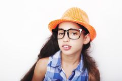 Image of a beautiful African young girl wearing hat and glasses. stock photos