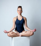 Image of beautiful ballerina meditates on cube Stock Photos
