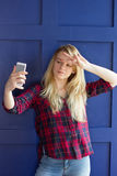 Image of beautiful blond young lady making selfie Royalty Free Stock Image