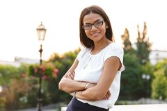 Beautiful business woman posing outdoors at the street looking camera. Image of a beautiful business woman posing outdoors at the street looking camera stock images