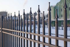 Image of a Beautiful decorative cast iron wrought fence with artistic forging. Metal guardrail close up.  Stock Photos