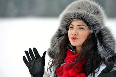 Image of beautiful female in luxurious fur head cloth. Outdoor in winter royalty free stock images