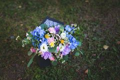 Image of beautiful flowers arrangement with blue hydrangea, white eustoma, spray roses, carnations stock image