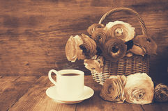 Image of beautiful flowers next to cup of coffee. sepia style vi Royalty Free Stock Images