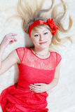 Image of beautiful funny young blond pinup woman happy looking & lying over white background Royalty Free Stock Image