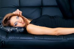 Image of a beautiful girl on a luxurious couch Royalty Free Stock Images