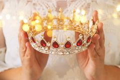 Image of beautiful lady with white lace dress holding diamond crown. fantasy medieval period. Image of beautiful lady with white lace dress holding diamond royalty free stock images