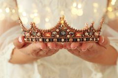 Image of beautiful lady with white lace dress holding diamond crown. fantasy medieval period. Royalty Free Stock Photo