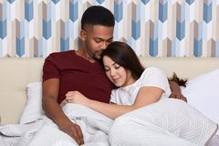 Image of beautiful loving couple laying in bed in morning, spending time together, relaxing at weekend, have good relationship, stock photography