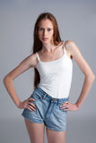 Image of beautiful skinny model on gray backdrop. Studio shot of beautiful skinny model on gray backdrop Stock Image