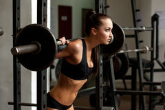 Image of beautiful slim girl lifting weight Stock Image