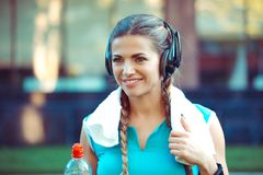 Sports woman outdoors on urban background with towel on neck stock photos