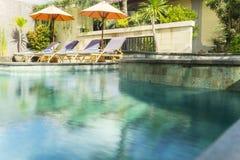 Beautiful swim pool with sunbed. Image of beautiful swim pool and sunbed in the luxury hotel Stock Image
