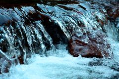 Water surface with ripples and sunrays reflections. An image of a beautiful water background. Abstract landscape of the rapids, Porcupine Mountains Wilderness royalty free stock images