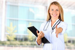 Image of beautiful woman doctor looking at camera and giving a hand stock images