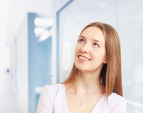 Image of beautiful woman smiling while thinking Stock Photos