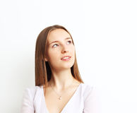 Image of beautiful woman thinking while smiling over white backg Royalty Free Stock Photography