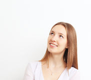 Image of beautiful woman thinking while smiling over white backg. Image of beautiful woman thinking while smiling on white background Stock Image
