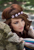 Hippie Woman in Flower Headband. An image of a beautiful woman wearing a flower headband and 1960s inspired makeup Royalty Free Stock Photography
