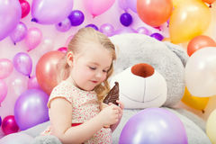 Image of beautiful young girl playing in game room Royalty Free Stock Images
