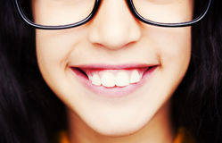 Image of a beautiful young girl wearing glasses. royalty free stock photography