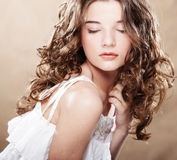 Image of beautiful young woman with curly hair Royalty Free Stock Image