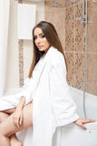 Image of beautiful young woman dressed in bathrobe Stock Images