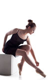 Image of beautiful young woman tying pointe Stock Photo