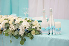 Image of a beautifully decorated wedding table. Image of a beautifully decorated with cloth, bouquet and accessory wedding table Royalty Free Stock Photo