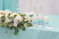 Image of a beautifully decorated wedding table. Image of a beautifully decorated with cloth, flowers and accessory wedding table Royalty Free Stock Photos