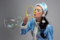Image of beauty snow maiden blowing soap bubble Stock Photos