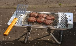 Burgers being cooked on portable BBQ Stock Images